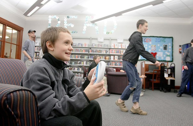Barrett (left) and Nathan Birks play video games during Teen Gaming Night at the Licking County Library in Newark on Dec. 19. Barrett and Nathan Birks play video games during Teen Gaming Night in the Licking County Library Wednesday evening, December 19, 2012.