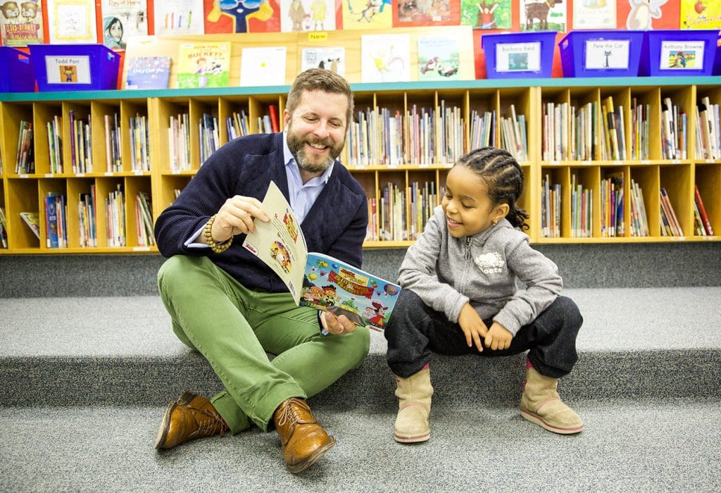 Michael-Tamblyn-reading-with-child