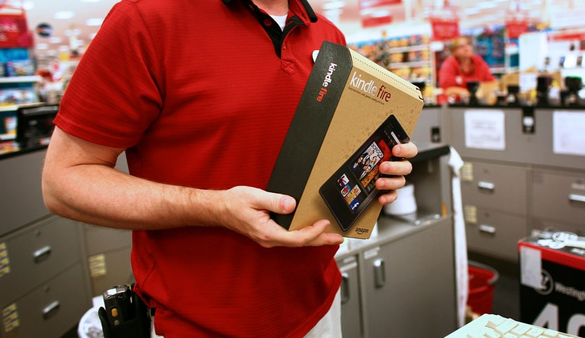 Sales Floor Team Leader Chris Davis holds a box containing an Amazon.com Inc. Kindle Fire tablet computer at a Super Target store in Denver, Colorado, U.S., on Tuesday, Nov. 15, 2011. Amazon.com Inc., the world's largest Internet retailer, and Discovery Communications Inc. settled their patent disputes over book readers and Internet shopping, according to court documents. Photographer: Matthew Staver/Bloomberg via Getty Images