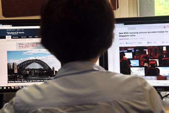 A person browses through media websites on a computer on May 30,