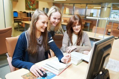 13425770-student-girls-working-with-computer-in-library
