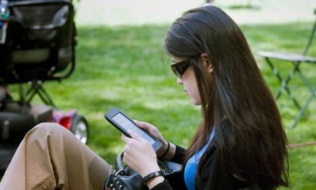 A reader uses her Nook ereader