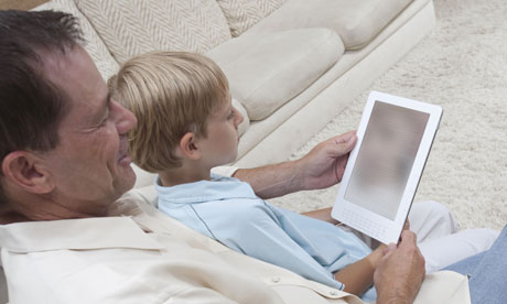 Father and son read an ebook