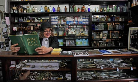 Wendy Conroy reads Ulysses in period costume in a Dublin chemist as Bloomsday festivities begin