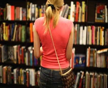 Woman-in-front-of-bookshop-window