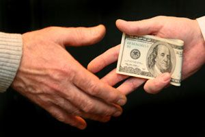bribe-money-changing-hands