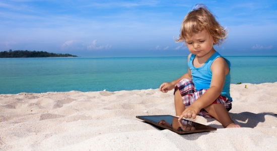 child-tablet-beach