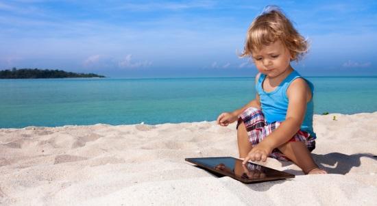 child-tablet-beach