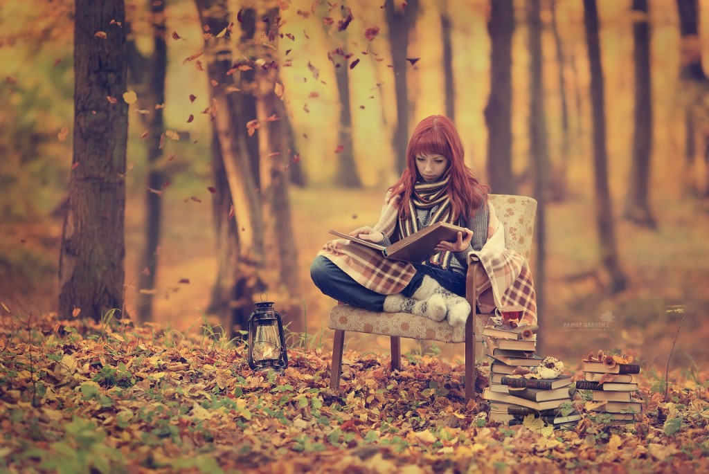 girl reading in fall woods