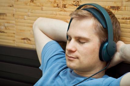 man-listening-headphones-eyes-shut