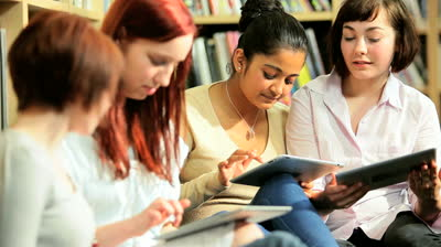 stock-footage-group-of-diverse-female-students-using-online-university-internet-on-tablet-computer-in-information