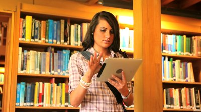 stock-footage-young-student-with-a-tablet-in-a-library