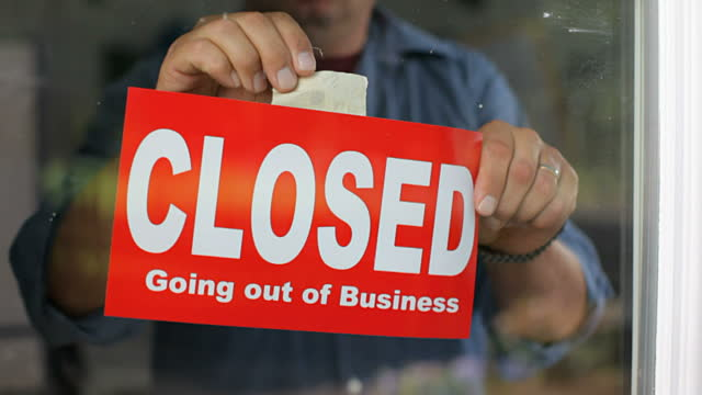 stock-video-17914560-going-out-of-business-closed-sign-on-window