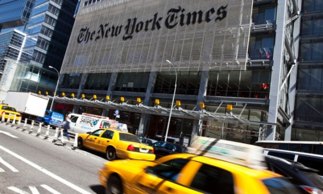 traffic-rushes-past-the-new-york-times-headquarters-in-new-york-city